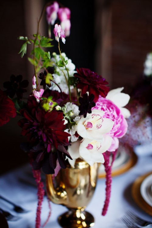 Orchid and peony centerpiece with bleeding hearts by
