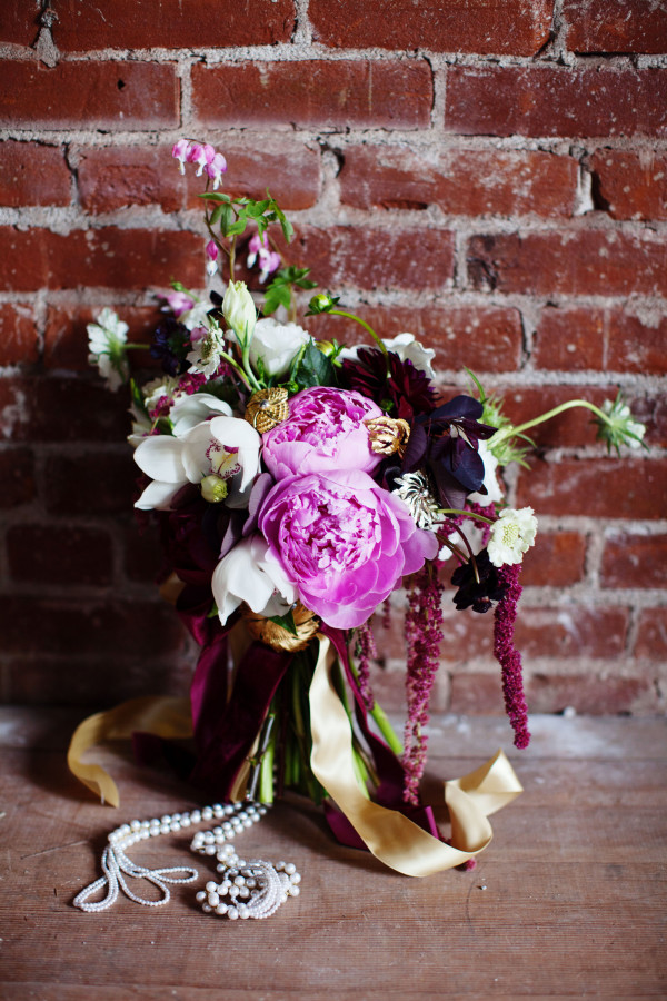 orchid and peony bouquet with brooches by Anastasia Ehlers | photo by Anne Nunn