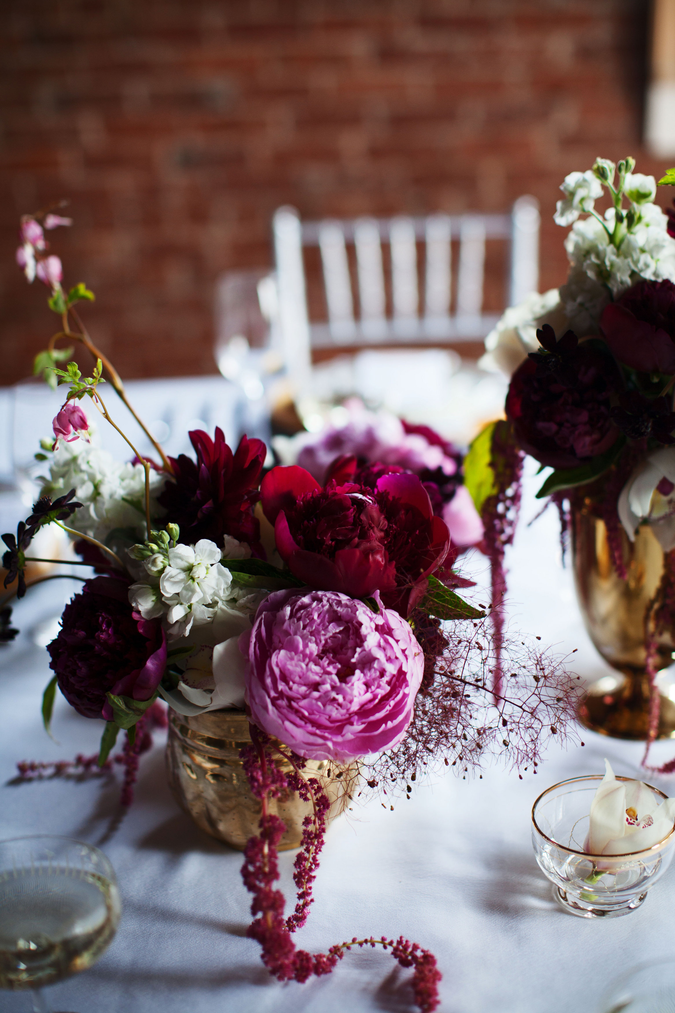 Burgundy and blush peony centerpiece with smokebush by