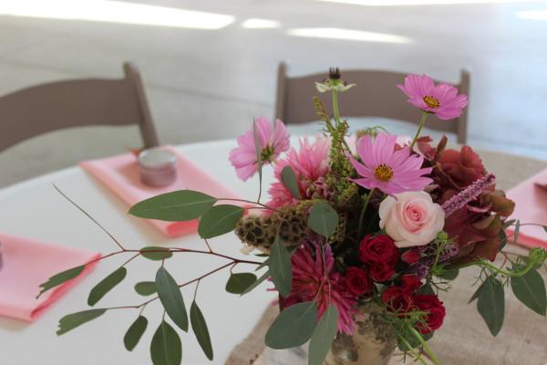 pink centerpiece with eucalyptus