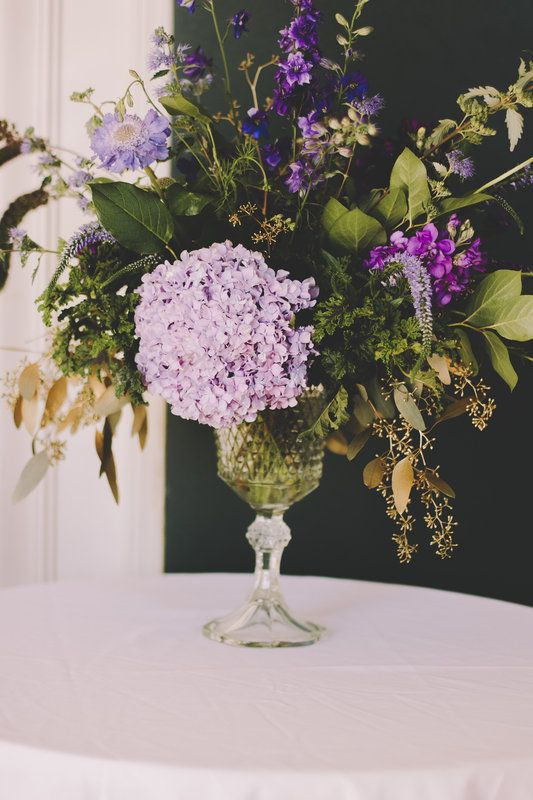 purple and gold accent arrangement by Anastasia Ehlers
