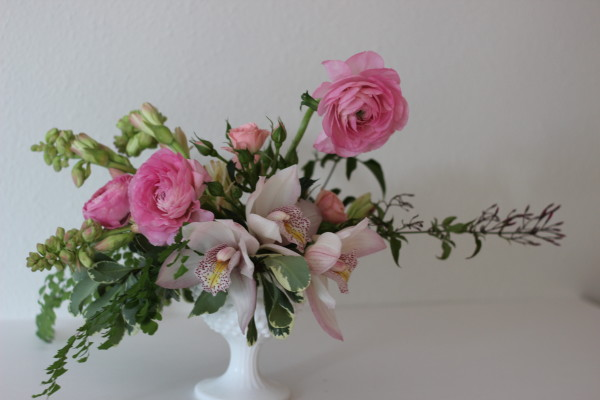 pink orchid and ranunculus arrangement by anastasia ehlers
