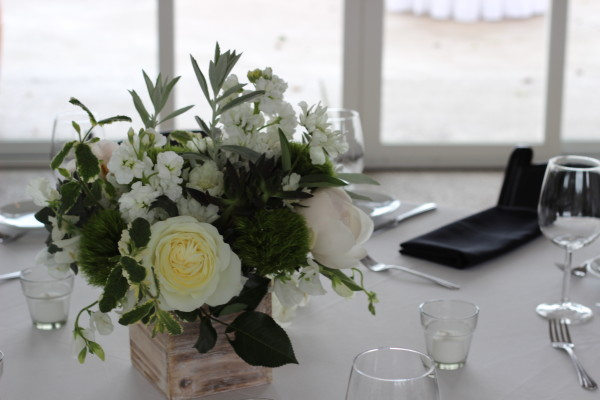 green and white centerpiece in a wood box by anastasia floral design