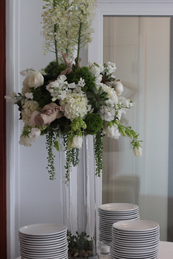 tall green and white centerpiece by anastasia floral
