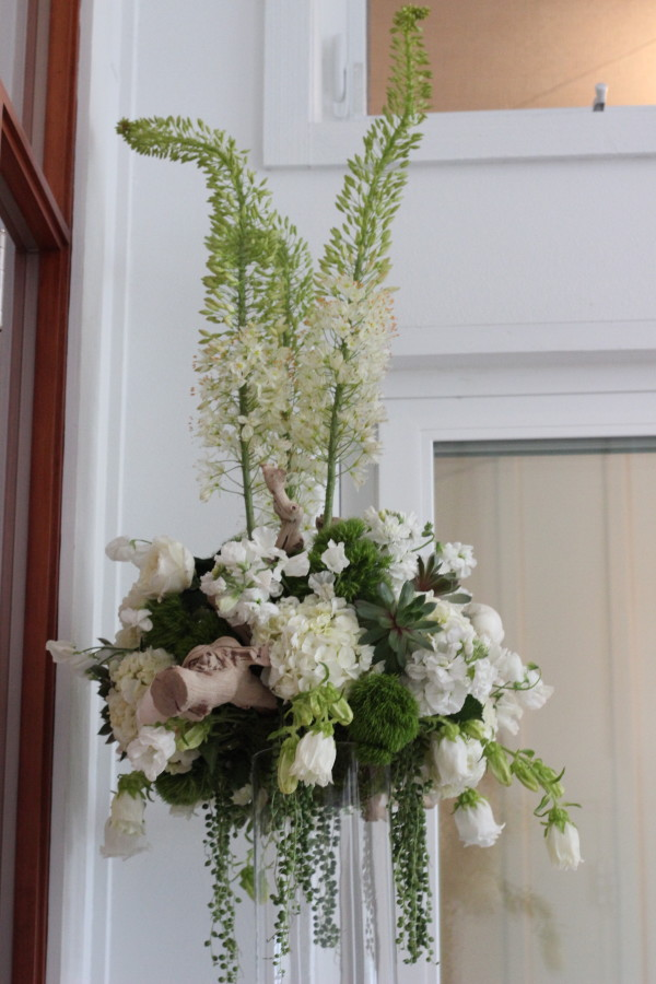 elevated arrangement with peonies, hydrangea, and grape wood by anastasia floral design
