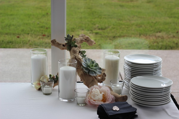succulents, candles, and grape wood with loose peonies by anastasia floral