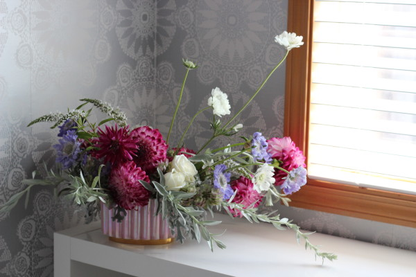 Pink and purple dahlia, scabiosa, and rose arrangement  by Anastasia Ehlers