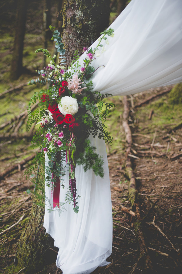 chiffon wedding altar with floral tieback by Anastasia Floral | photo by Cat Dossett