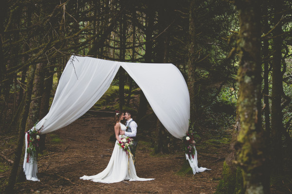 fabric draped altar in the woods | flowers by Anastasia Floral | photo by Cat Dossett