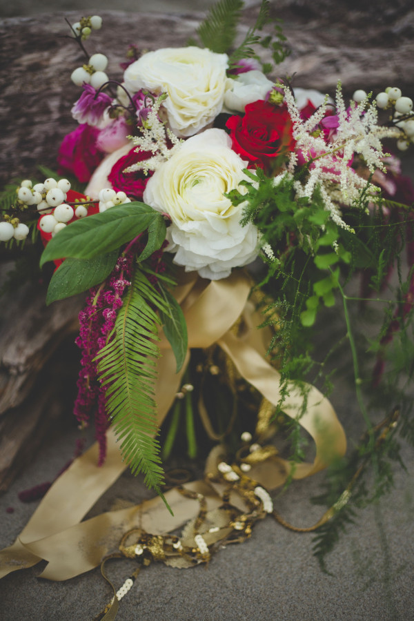 gold-trimmed woodsy bouquet with Japanese ranunculus, astilbe, snowberries, and ferns by Anastasia Floral | photo by Cat Dossett